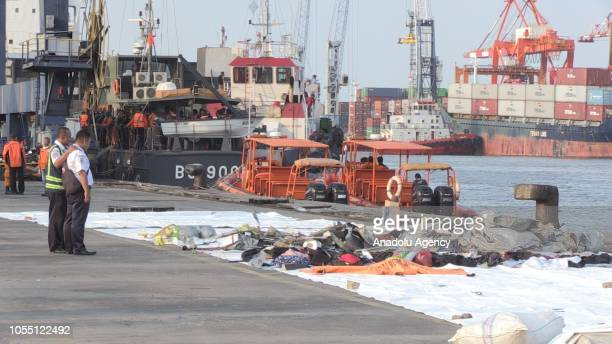 Officers collect the belongings found in the plane after Indonesian passenger plane Lion Air JT610 crashed into the sea off the countrys West Java...