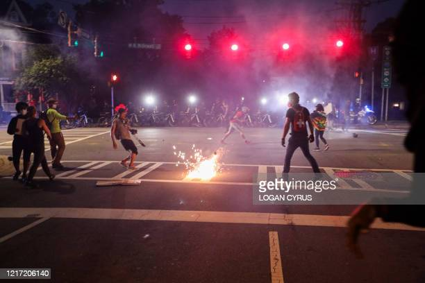 CMPD officers deploy a stun grenade during a demonstration for the end of police brutaity in uptown Charlotte North Carolina on June 2 2020 US...