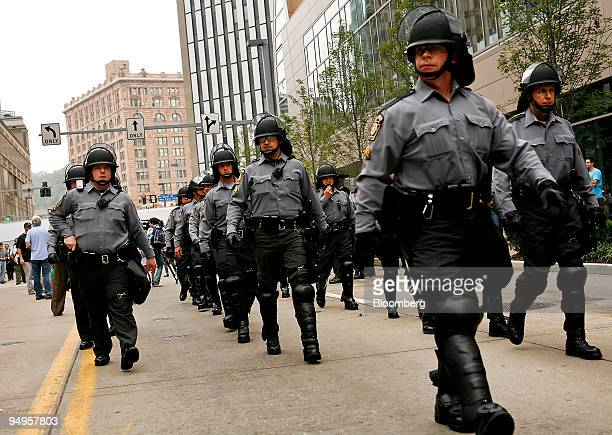 Officers dressed in riot gear monitor protests during day one of the Group of 20 summit in Pittsburgh Pennsylvania US on Thursday Sept 24 2009 G20...