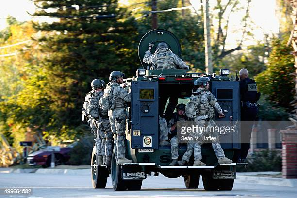 SWAT officers enter an area where suspects were believed to be after the shooting at the Inland Regional Center on December 2 2015 in San Bernardino...
