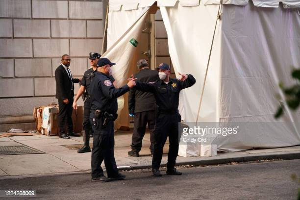 Officers exit the makeshift morgue at Lenox Hill Hospital before escorting the body of Glen Ridge New Jersey police officer Charles Roberts on May 11...