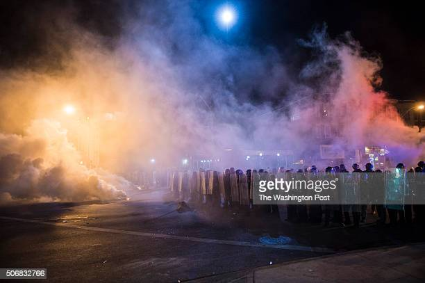 Officers fire tear gas an d pepper balls as protestors walk for Freddie Gray on West North Avenue and protest around the city in Baltimore MD on...