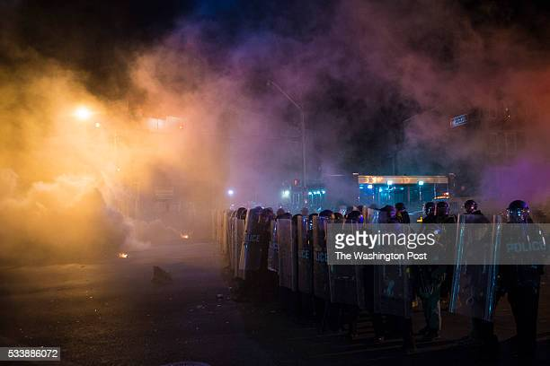 Officers fire tear gas and pepper balls to clear the streets after the 10pm curfew near the intersection of West North Avenue and Pennsylvania Avenue...