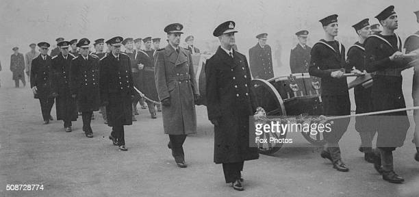 Officers flanking the coffin on Admiral Sir Dudley Pounds on their way to Westminster Abbey including Admiral Sir Andrew Cunningham and Air Chief...
