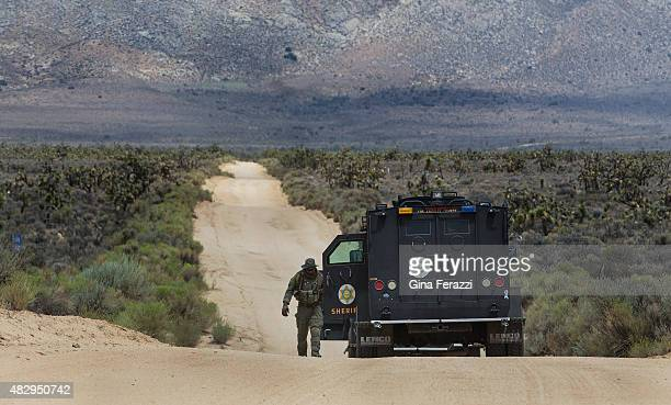 SWAT officers from Los Angeles County search along the remote Kelso Creek Road for a murder suspect who also shot and wounded two Kern County Sheriff...