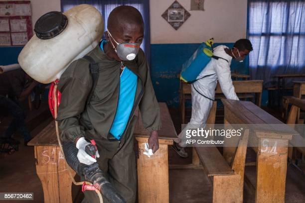 Officers from Ministry of Health spread pesticide against carriers of plague such as fleas in a primary school at Andraisoro a district of the...