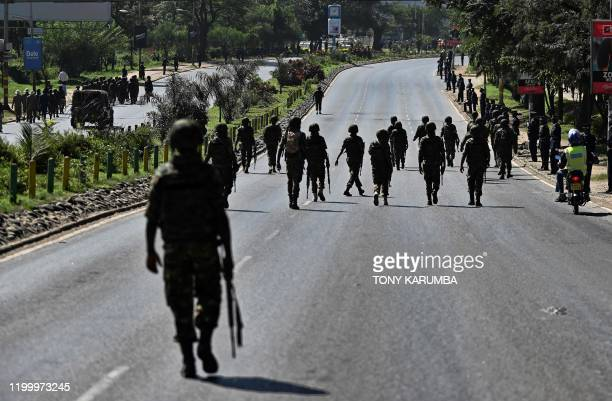Officers from the Kenya Police Service head towards the Nyayo National Stadium on February 11 where Kenya's former president the late Daniel arap...