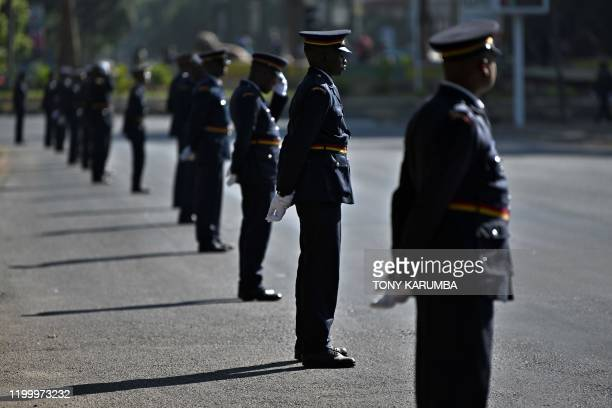 Officers from the Kenya Police Service parade in ceremonial uniform along the route of a cortege bearing Kenya's former president the late Daniel...