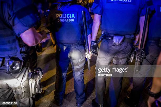 Officers from the Mossos d'Esquadra police force block the route of an antifascist demonstration in a residential neighbourhood of the Sant Gervasi...