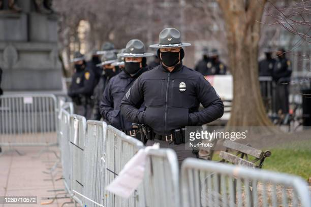 Officers from the Ohio State Patrol stand guard as members of Antifa march from City Hall to the Ohio Statehouse after President Joe Biden was sworn...