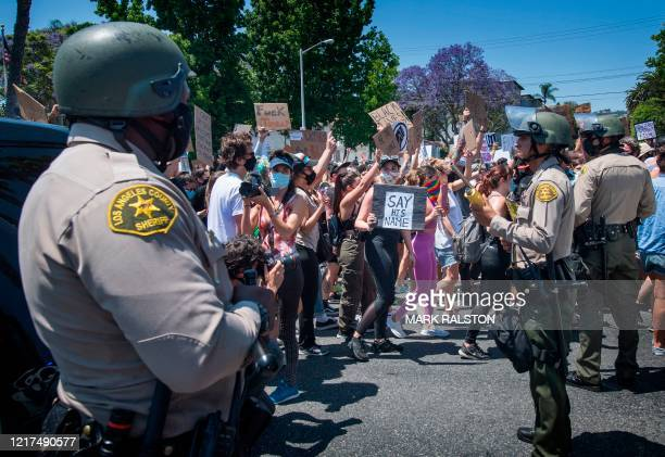 Officers from the Sheriff's Department keep watch as demonstrators continued to protest the death of George Floyd, in West Hollywood, California on...