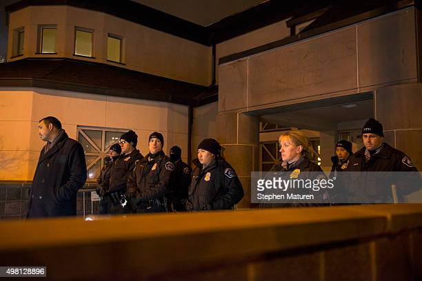 Officers gather outside the 4th Precinct police station November 20, 2015 in Minneapolis, Minnesota. Activists are keeping up pressure for more...