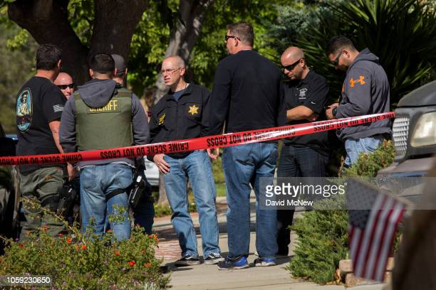 Officers gather outside the house of dead shooting suspect Ian David Long following a mass shooting at the Borderline Bar and Grill on November 8,...
