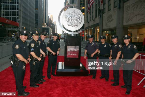Officers in the NYPD pose outside of Radio City Music Hall during the 71st Annual Tony Awards at 3 West Club on June 11, 2017 in New York City.
