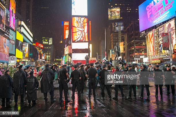 nypd officers in times square during black lives matter protest - black lives matter stock pictures, royalty-free photos & images