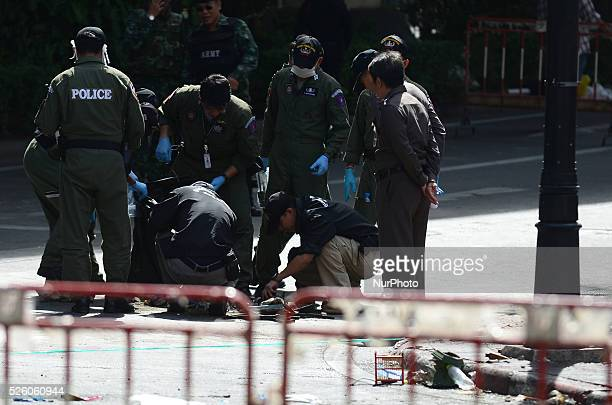 Officers inspects the site of the bomb blast at the Erawan Shrine in Bangkok, Thailand on August 18, 2015. In the evening on August 17, The bomb...