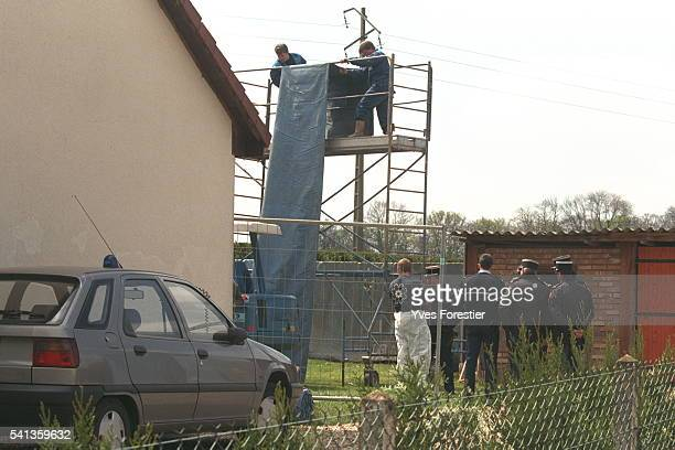 Officers install a covered scaffolding against the paparazzi during the reconstruction