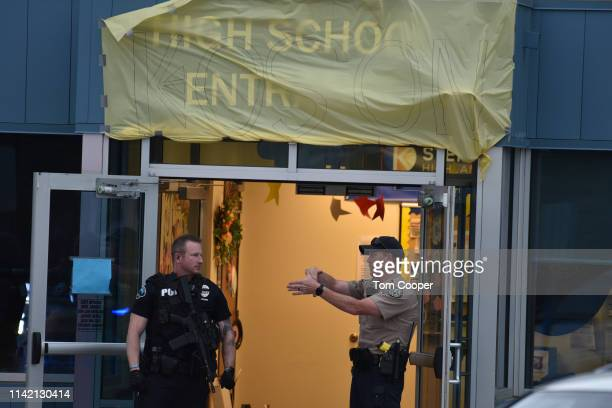 Officers investigate the scene of a shooting in which at least seven students were injured at the STEM School Highlands Ranch on May 7 2019 in...