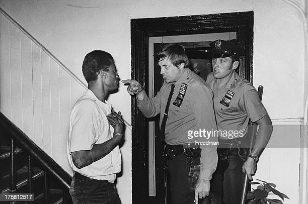 Officers Liedy and Glass of the NYPD 9th Precinct arrest a man for causing a disturbance at a cheap hotel in Alphabet City New York City circa 1979