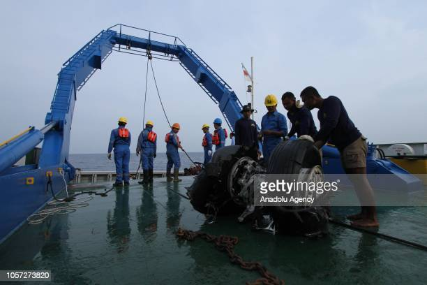 Officers lift the wheels of the Lion Air JT 610 plane which has been found at Karawang Sea using a crane in West Java Indonesia on November 4 2018...