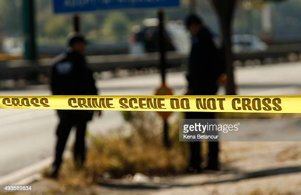 Officers looks for evidence at the FDR Drive as investigations continue after a NYPD officer was killed in a confrontation with an armed suspect...
