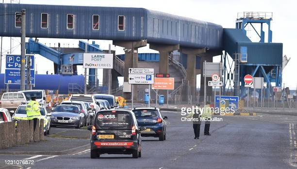 Officers man a police checkpoint at Larne harbour on February 10, 2021 in Larne, Northern Ireland. Port inspection staff have returned to work today...