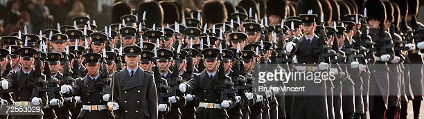 Officers march up to Buckingham Palace after HRH Queen Elizabeth II delivered a speech at the state opening of Parliament on November 15, 2006 in...