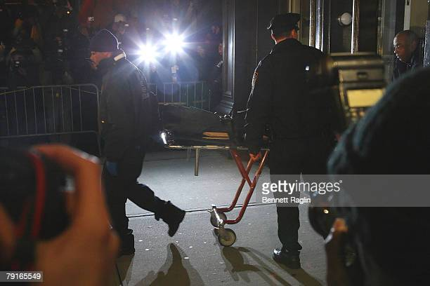NYPD officers move the body of actor Heath Ledger a into vehicle outside of the SoHo apartment building were he was found dead this afternoon January...