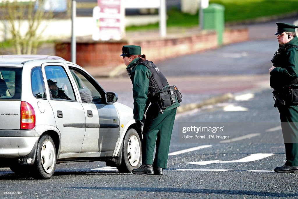 Officers near the scene in Highfield Close, Omagh, where a young Catholic police officer was killed yesterday by a booby-trap car bomb in Northern Ireland.