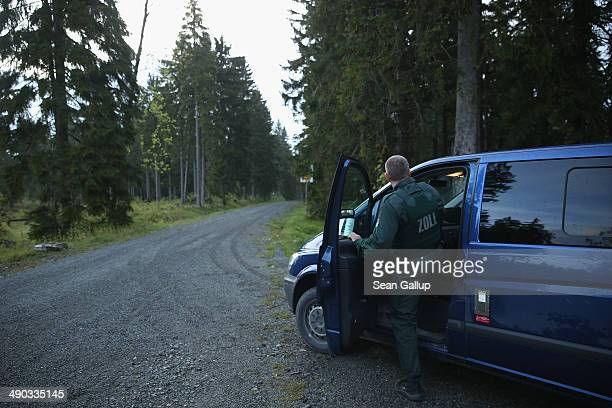 Officers of German Customs who asked not to be identified check a forest road on the border to the Czech Republic while patrolling for crystal meth...