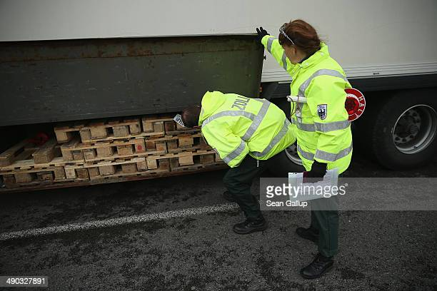 Officers of German Customs who asked not to be identified search a truck while patrolling for crystal meth and other contraband smuggling on May 13...