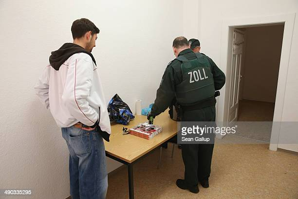 Officers of German Customs who asked not to be identified search the personal belongings of a young man who tested positive for methamphetamine usage...