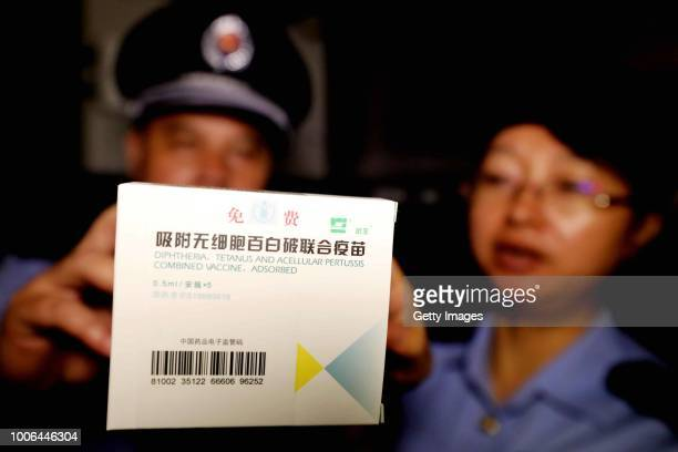 Officers of local market regulation administration inspect DPT vaccinations produced by Wuhan Institute of Biological Products Co.,Ltd. At the Center...
