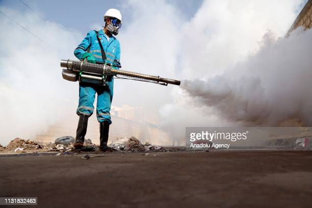 Officers of Ministry of Environment and Water of Yemen carry out disinfection works to prevent spreading epidemic cholera in one of the most affected...
