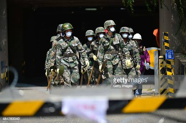 Officers of pontoon bridge forces work in a residential building near the core area of Tianjin blasts on August 16 2015 in Tianjin China A total of...