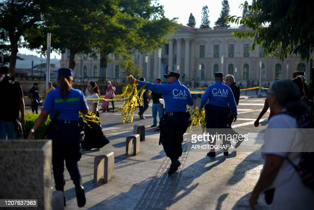 Officers of San Salvador's municipal police close down a on March 18 2020 in San Salvador El Salvador Despite no cases of COVID19 have been confirmed...