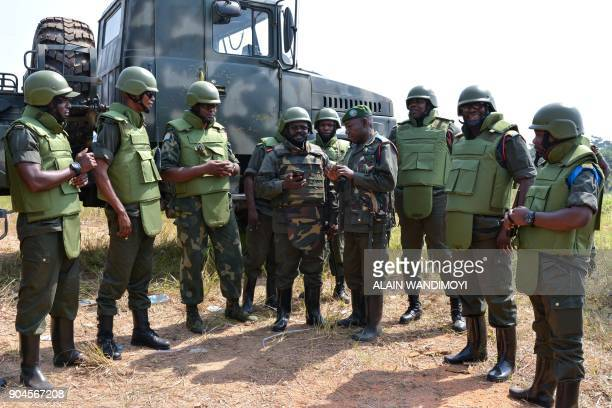 Officers of the Armed Forces of the Democratic Republic of the Congo talk to the troops in Matombo 35km north of Beni North Kivu on January 13 during...