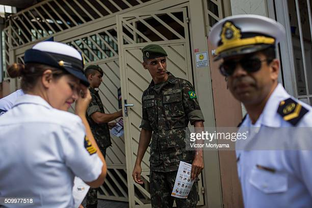 Officers of the Army, Navy and Air Force reach out to Brazilian residents in a push for public awareness of the Zika virus and the mosquito that...