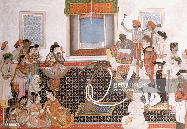 Officers of the British East India Company being entertained by musicians and dancers One of the European officers smokes a large hookah India Moghul...
