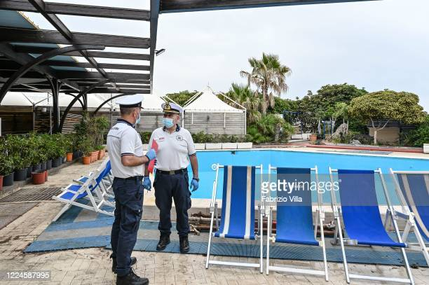 Officers of the Coast Guard control the restoration works of a bathing establishment after the security measures against Covid19 to follow for 'phase...