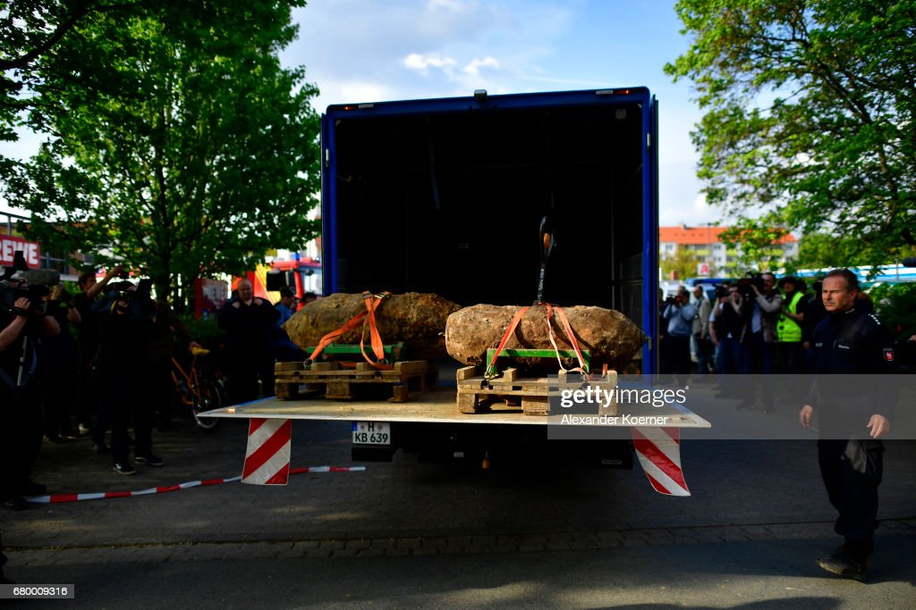 Officers of the Explosive Ordnance Disposal Division (EOD) showcase two five centner and one ten centner bomb on to a truck after dismantling the bombs on May 7, 2017 in Hanover, Germany. Bomb disposal experts have checked five locations in the city today where unexploded bombs from World War II might possibly lie underground, two five centner and one ten centner bomb were found and dismantled. Today's evacuation is among the largest ever in post-World War II Germany. Unexploded World War II bombs, mostly from Allied aerial bombing, remain a deadly legacy and smaller scale evacuations are a regular occurrence in major urban centers across Germany throughout the year.