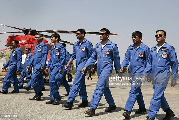 Officers of the Indian Airforce Sarang helicopter aerobatics team walk across the tarmac at the Yelahanka Air Force Station in Bangalore February 8...
