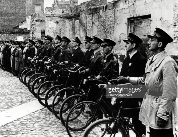 Officers of the Jewish Ghetto Police or Jewish Order Service in the Warsaw Ghetto during World War II, Poland, summer 1941. They were an auxiliary...