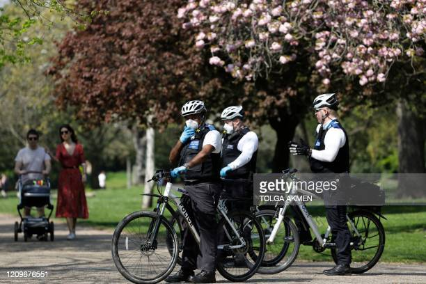 Officers of the Metropolitan Police patro in Victoria Park, east London on April 11, 2020 as warm weather tests the nationwide lockdown due to the...