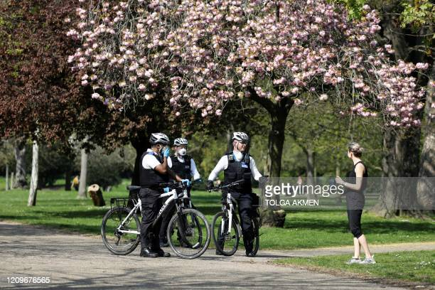 Officers of the Metropolitan Police patrol in Victoria Park east London on April 11 2020 as warm weather tests the nationwide lockdown due to the...