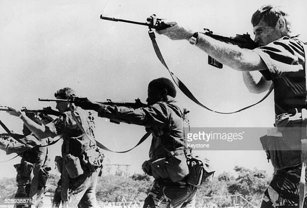 Officers of the Rhodesian army take part in firing practice at the School of Infantry in Gwelo 14th June 1977 The first eleven African officers have...