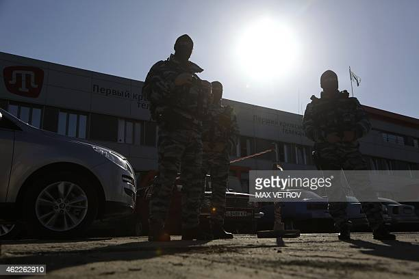 Officers of the Russian riot police force OMON stand guard outside the offices of Crimean Tatar TV channel ATR in Simferopol on January 26 2015 A...