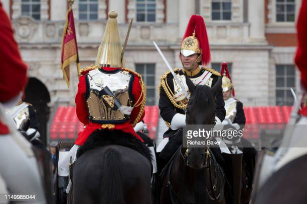 Officers of the The Queen's Life Guard and the Blues and Royals change the guard during the daily ceremonial in Horse Guards Parade, on 11th June...