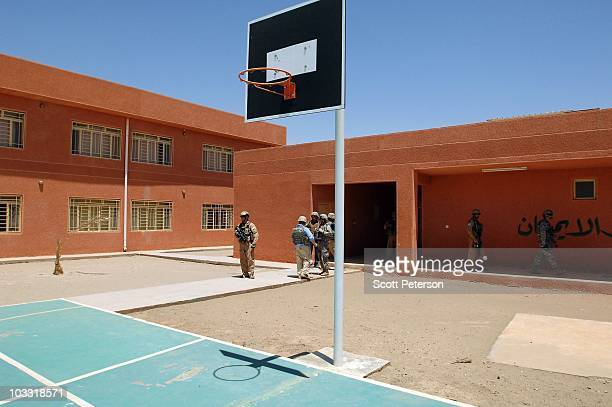 Officers of the US Army Corps of Engineers inspect the completed USfunded AlShuhada School project in Fallujah Iraq on July 23 2010 The USACE has...