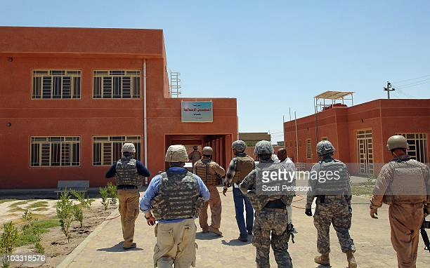 Officers of the US Army Corps of Engineers inspect the completed AlShuhada School project in Fallujah Iraq on July 23 2010 The USACE has spent $190...